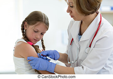 Doctor give injection to girl's arm