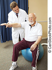 Chiropractor helping senior patient with physical therapy routine.