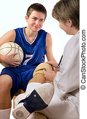 first aid - doctor giving first aid the hurt sportsman