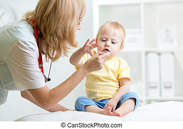 doctor giving medicament with a spoon - female doctor giving...