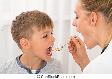 Doctor Giving Medicine To Boy