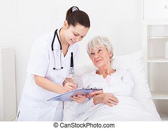 Doctor Giving Prescriptions To Patient - Senior Female ...
