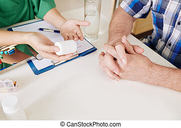 Doctor giving recommendations to senior patient - Hands of ...