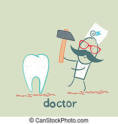 doctor hammers on the tooth