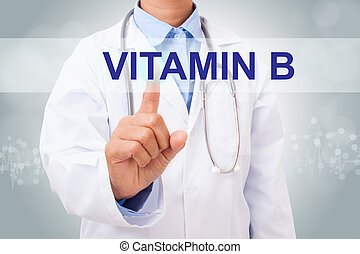 Doctor hand touching Vitamin B sign on virtual screen. ...