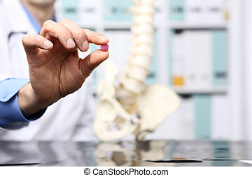 doctor hand with pill, healthcare and medical concept