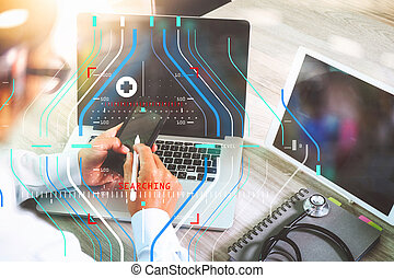 doctor hand working with modern digital tablet and laptop computer with computer interface as medical network concept