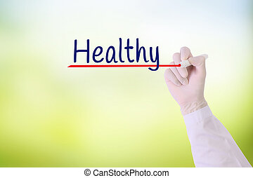 Doctor hand writing unHealthy ,Healthy with marker on   on visual screen over green nature blurred background.