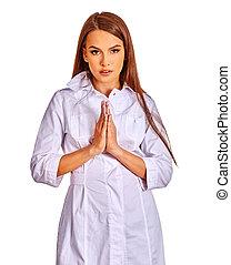 Doctor hands folded in prayer.
