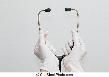 Doctor hands holding a stethoscope, medical concept