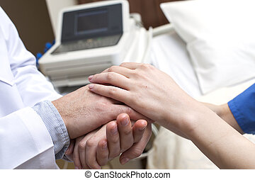 Doctor hands patient hospital