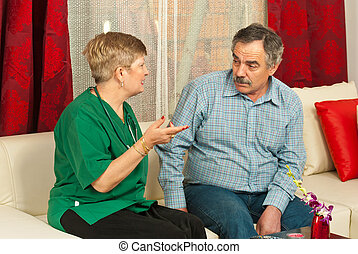 Doctor having conversation with mature man