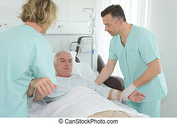 doctor helping a senior patient on bed