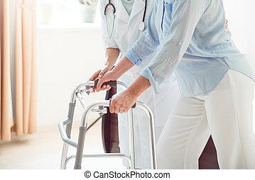 Doctor helping her patient