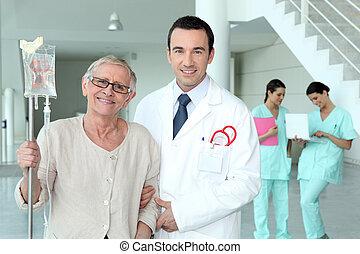 Doctor helping his patient walk