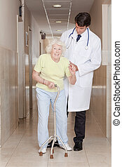 Doctor helping Patient use Walking Stick