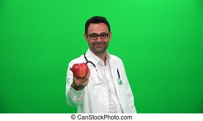 Doctor Holding an Apple Against a Green Screen