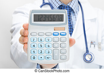 Doctor holding calculator in hand - health care concept