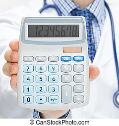 Doctor holding calculator in hand - health care concept - studio shot