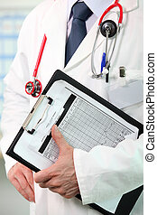 Doctor holding clipboard with patients results