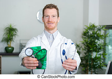 doctor holding devices for taking blood pressure