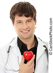 Doctor holding heart shape toy