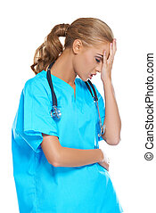 Doctor holding her head in anguish