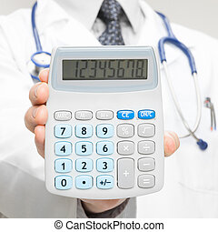 Doctor holding in his hand calculator - closeup shot - 1 to 1 ratio