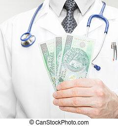 Doctor holding money in his hand - closeup studio shot - 1 to 1 ratio
