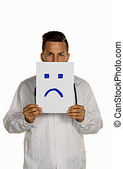 doctor holding negative smiley face before
