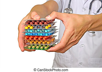 Doctor holding pills in hand on white background