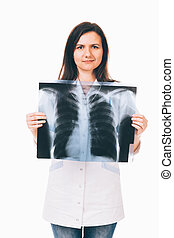 Doctor holding radiography in front of chest