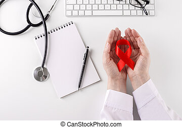 Doctor holding red ribbon