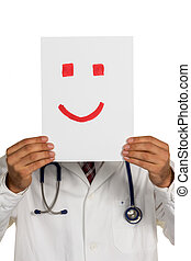 doctor holding smiley face before