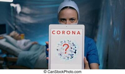 Doctor holding tablet in hospital, coronavirus concept.