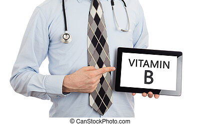 Doctor holding tablet - Vitamin B - Doctor, isolated on ...