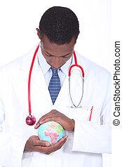 Doctor holding world globe