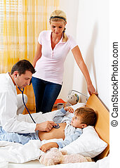doctor house call. - a doctor at home visits. examines a...