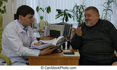 Doctor in a white coat consults fat man patient in clinic. Medicine helps to cure a sick person and preserve health of people
