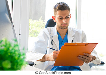 doctor in consultation with documents or reports