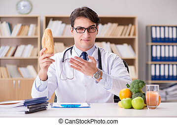 Doctor in dieting concept with fruits and vegetables