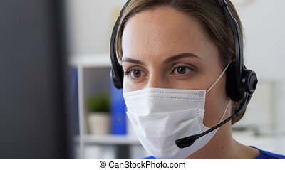 doctor in mask with headset and computer at clinic