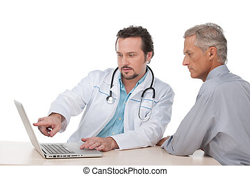 Doctor in white robe showing on laptop test results to his patient. Sitting over white background