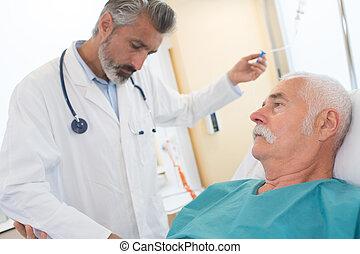 doctor inject liquid to patient