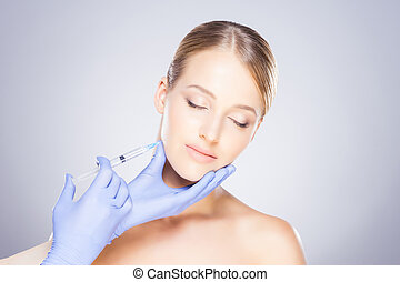Doctor injecting botox into a woman's face - Doctor ...