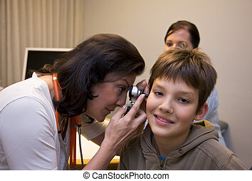 Doctor investigated child - Doctor examines a young patient