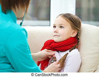 Doctor is examining little girl using stethoscope