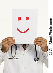 doctor is holding smiley face