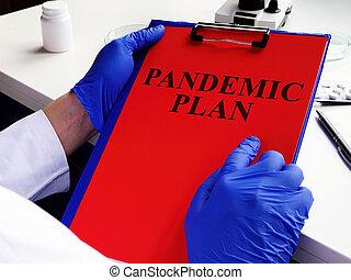 Doctor is reading pandemic plan for preparedness.