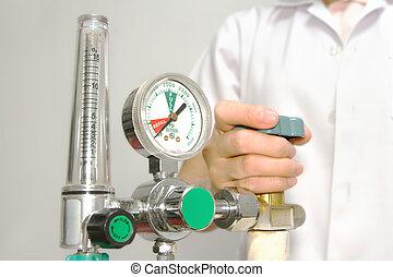 doctor is setting oxygen valve